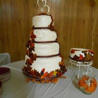 Autum Wedding Cake Autum themed wedding cake with fondant leaves, royal icing scroll work and covered in fondant