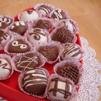 Box Of Chocolates   Inspired by Bakerella.blogspot.comCream Cheese pound cake with Red velvet and white chocolate whisper cake balls!