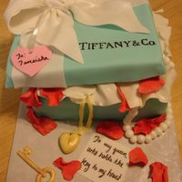 Key To My Heart  I made this red velvet cake in the shape of a Tiffany's Box. The customer wanted pearls and a heart locket coming out with a key with...