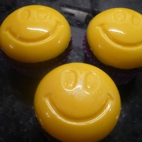 Smiley Cupcakes Cupcakes with choc/candy smiley on top of chocolate fudge & one had sparkles.