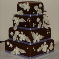 "Brown And Lavender A 12"", 10"", 8"", 6"" alternating tiers of WASC and Red velvet. Gumpaste flowers. Thanks for looking!!"
