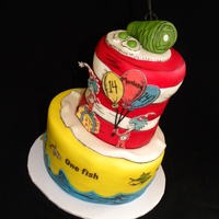"I Love Dr. Seuss!! An 8"" base, with a 6"" tall carved 5"" round cake for the hat. Fondant accents."