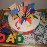 Explosion Fathers' Day Cake The 12'' cake is a golden cake filled with guayaba cream and covered with fondant cover I use red color fondant for the base and...
