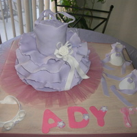 Baby Ballerina Cake W/ Zapatillas /diadema this is a 1rs Birday cake I make 2 cakes one for the base and one for the blouse