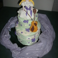 Violinista's Girl THIS CAKE IS MAKE ON MARSHMELOW CREAM AND FONDAT DECORATIONS