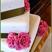 Green And Pink Offset Wedding Cake Green Ribbon, Pink Roses on rotated bases with diamantes