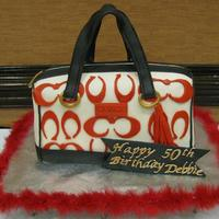 Coach Purse   B-Day girl likes red, black and gold....