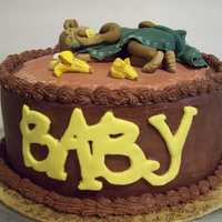 Baby Monkey Cake Chocolate cake with chocolate icing and fondant accents.