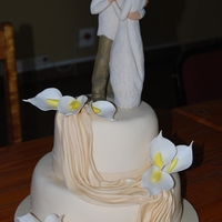 Drap Vowel Renewal Cake this was a vowel renewal cake I did for a friends sister, the topper is a 'Willow Tree Topper' and the Lilies are gumpaste. it...