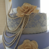 Pearl And Lace Wedding Cake This is a Vintage inspired Pearl and Lace Wedding Cake with Sugar Roses