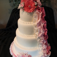 Pink Ruffles Wedding Cake I just loved loved making this cake.. 3 different colors of ruffles down side made Fondarific fondant
