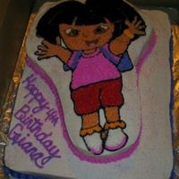 Dora The Explorer 1/2 sheet white cake with Dora the explorer shape pan.