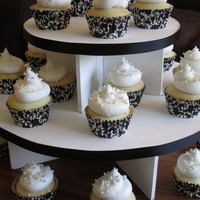 Engagement Party Cupcakes Simple white cake with vanilla buttercream swirl., edible pearls in Reynold's Stay Bright cupcake wrappers. Thanks for looking!