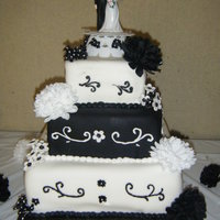 Black And White Wedding Chocolate mocha cake with cholate mocha filling. Covered in fondant.