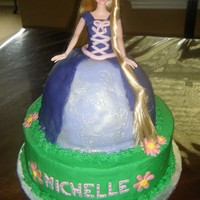 Rapunzel Cake Based on Walt Disney Tangled. Chocolate cake on bottom and Italian Cream cake top.