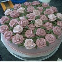 Rose Garden Cake Chocolate fudge cake, filled and iced w/ buttercream. Buttercream roses and leaves. Really fun to make, and really fun to see the reaction...