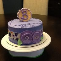 Purple Flowers Bday Cake Hand painted the fondant strip around cake.