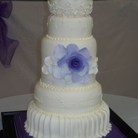 "Brianna And Shawn 12"",10"", 8""(tall tier),6"", and ball cakes, All were vanilla cake with lemon curd and raspberry filling, covered in..."