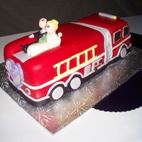 Brianna And Shawn 2 Sculpted fire engine as groom is a vonlunteer firefighter, cake was chocolate with peanut butter buttercream. Covered in fondant with...