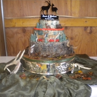 Camo Wedding Cake This Camo Cake was for a couple that were avid hunters. They wanted deer, elk and moose incorporated on it with hunter orange around it....