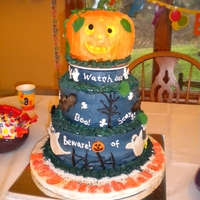 1St Birthday Halloween Cake   My grandson's first birthday and it is on Halloween. Yellow, White and Chocolate, IMBC with cand clay figurines.