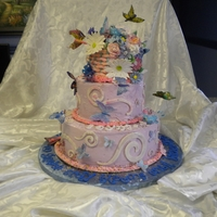 Butterflies & Flowers This was a college graduation cake. The larger decorated butterflies are gelatin and the smaller gumpaste. The flowers were gumpaste and...