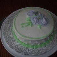 Course 1 Wiltons Cake Class This is my first time making roses I think I did ok. With more pratice I can only get better!