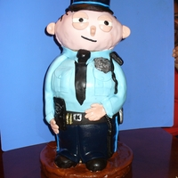 Stewie Birthday Cake 3D sculpted standing STEWIE the cop character. I designed this cake for my son-in-law's birthday, he is a cop and watches the show...