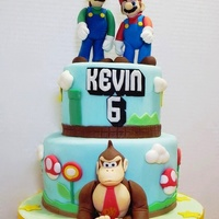 Super Mario Bros. And Donkey Kong Birthday Cake 5&7 inch chocolate cake with strawberry buttercream. The figures are made of the mix of fondant and tylose powder