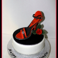Stiletto Shoe Cake I made this cake for my sister. Its red velvet cake with cream cheese filling. The shoe is made with gumpaste. She loved it.