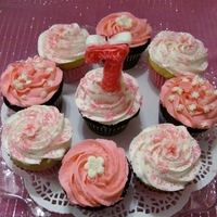 Pink And White Birthday Cupcakes - Buttercream Swirl Pink and White Cupcakes done with a buttercream swirl and a variety of toppings (fondant flowers, edible glitter, colored sugar crystals,...