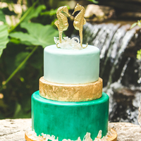 Isomalt Sea Glass On Top And Bottom Of Cake Bottom Tier Hand Painted For Water Color Effect Middle Tier Has Edible Gold Leaf Top Tier I  Isomalt sea glass on top and bottom of cake.Bottom tier hand painted for water color effect.Middle tier has edible gold leaf. Top tier I...