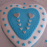 Heart Anniversary Fondant cover cake with soft butter cream filling.