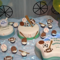 Sport Baby Cake Fondant covered cake and accents + cupcakes.