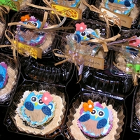 Luau Owl Cupcakes Cupcakes I made and donated to my son's school luau. The school mascot is an owl. Sand is cookies and brown sugar from the food...