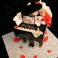 Piano Cake Done for the chorus teacher at my son's school. fondant/gumpaste flowers. Piano lid is fondant over cardboard (only had two days...