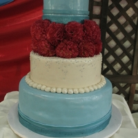 Red And Aqua Wedding My own wedding cake. Chocolate bottom tier, the rest are dummies. Silk carnations in the middle; would have preferred gumpaste but I didn&#...