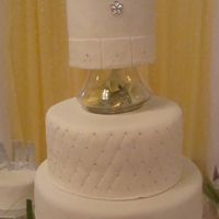 Sparkled Wedding Cake Almond cake covered in fondant with edible sparkle accents and gum paste letters. The bride wanted the cake simple, all white and just a...