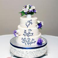 3 Tier Buttercream Ivory buttercream with hand piped scroll work