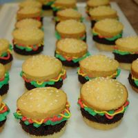 Mini Burgers Yellow cake cupcakes with chocolate cake for burger patties. Buttercream icing for ketchup, lettuce, mustard and sesame seeds. So easy to...