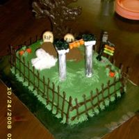 Graveyard Cake Cream cheese (canned - I didn't know any better) frosting with piped chocolate fencing and tree. Headstones are milano cookies and...