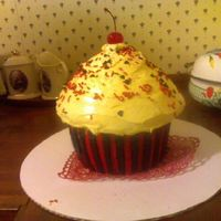 Valentine's Day Giant Cupcake My first time using the Wilton's Giant Cupcake pan, i can't wait to keep practicing on them! It was A LOT of fun making this, i...