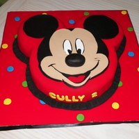 Mickey Mouse Birthday 8in and 5in rounds, covered in fondant.