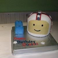 Lego Head With Evil Knievel Helmet Couldn't decide if he wanted a lego cake or an Evil Knievel cake.