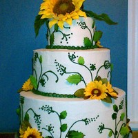 Sunflower Wedding Cake 3 tier (12, 10, 6) Marble cake, vanilla buttercream, silk sunflowers.