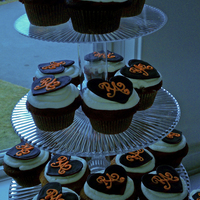 Navy And Orange Heart Cupcakes Choc., Carrot cake, Red Velvet cupakes with RI hearts (navy) with Bride and Groom's first initials (orange).