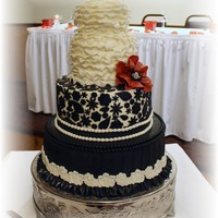 Black Ivory And Red Wedding Cake   Black, ivory, and red wedding cake.