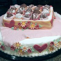 Box Of Truffles On Pink Tablecloth With Flowers And Hearts