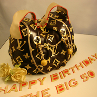 Lv Purse Cake A husband called and we delivered. He saw our great purse cakes and just knew his wife would love to have one for her 50th birthday to go...