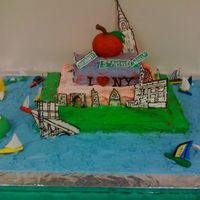 New York City - The Big Apple This was for a New York City cake. I made the buildings and statue of liberty using chocolate transfers. I used white and milk chocolate,...
